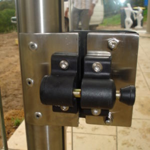 Round posts with side pull latch