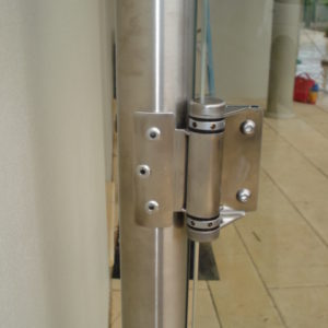 Stainless steel round posts with spring hinges